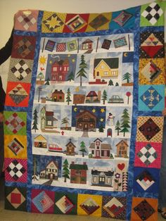 Buildings, trees, and sampler quilt