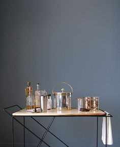 """In 2014, Basil Hayden's commissioned Greta de Parry to make """"the quintessential bar cart"""". The challenge was quickly accepted. Day to day most bar carts aren't being rolled around, so The Coleman Bar"""