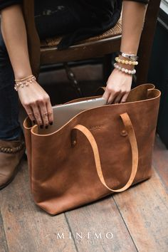 "Tote bag : Beatrix Price 4,500 Baht ($135) Color Oak Brown , Antique Orange , Imperial Red Size Width 15"" x Thick 5.5"" x High 13"" Weight 0.9 kg. Genuine Leather, this model are popular for the ones who love Simple clean and Cool style. Every MINIMO bag was embroidered by hand with meticulous attention to detail and quality. But still keep raw style leather and thread line by artisans who has experience over 10 years in making bags. www.facebook.com/Minimo.thailand"