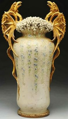 Pterodactyls Vase by Amphora, ca. 1897. The Amphora porcelain works existed from 1892-1945 in the Teplitz-Turn area of Bohemia, a part of Austro-Hungary. In their half a century of production, Amphora became known as a fine art pottery manufacturer of exceptional quality. They produced a plethora of innovative designs & shapes with a high level of detail, and were considered by many to exemplify the Art Nouveau style.