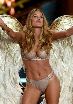 Model Doutzen Kroes walks the runway during the 2014 Victoria s Secret  Fashion Show at Earl s Court 435f6945200