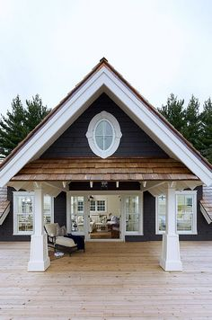 Dark grey siding white trim | Lily Pad Cottage