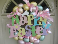This is a pastel colored Easter egg wreath for over the door or inside your home. Colors consist of yellow, green, tan, pinks and purples all in pastel. Pink ribbons all throughout and the Easter Logo is in pastel colors with sparkles.