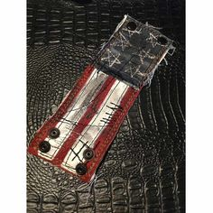 Handmade red,white and blue distressed leather flag wrist cuff with stitched stars. www.ForgottenSaintsLa.com