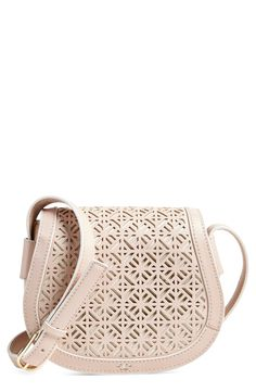 Striking geometric perforations enhance the vintage sophistication of this curvaceous leather bag with a saddle-inspired silhouette.
