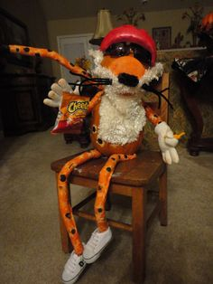 Can you believe that this is a decorated pumpkin! Meet Chester the Cheetos Cheetah Pumpkin!