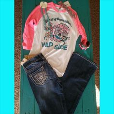 Look at this super cute outfit!!! Wild Side Shirt with A Pair Of Our Cowgirl Up Jeans,Turquoise Cross Necklace, Hammered Cross Leather Cuff Bracelet and A Chevron Headband   Order at www.danddwesternwear.com
