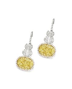 PAIR OF FANCY YELLOW DIAMOND AND DIAMOND PENDENT EARRINGS | Each suspending on…