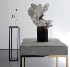 Carol Bove's Coral Sculpture (2008), in the foreground, and Heraclitus (2014