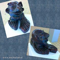 Head on feet (acc. to Jeroen Bosch) Clay sculpture www.michaelart.nl