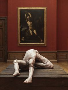 berlinde de bruyckere's 'we are all flesh'  in front of a painting by luca giordano