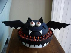 I love bats, halloween, and cake. this is perfect.