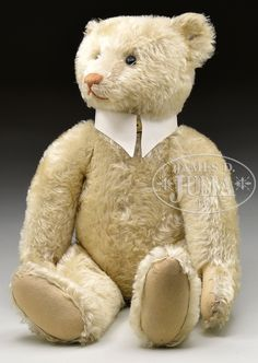 "LARGE IMPORTANT WHITE STEIFF MOHAIR BEAR WITH small trailing ""F"" BUTTON and traces of white ear tag and working growler"