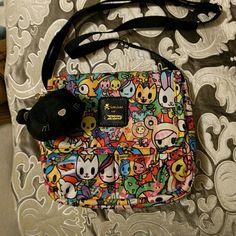 Crossbody Tokidoki bag Super cute Tokidoki crossbody bag. Never used or worn. Adjustable strap, flap top and 2 exterior pockets in the front. tokidoki Bags Crossbody Bags