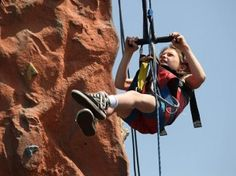 The only limits are the ones you set for yourself! Geneva Hamilton uses adaptive technology to ascend a climbing wall on Monday at Sumner Danbury Elementary School. Paraplegic rock climber Ma...