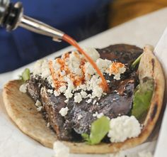 Top 10 Tuesday: Baltimore Farmers' Market eats [Pictures] : The warm pita stuffed with soy-marinated portabello and feta cheese and dressed with hot sauce is pretty much a Baltimore farmers market classic. The oyster fritter from the same stand has its fan club, too.