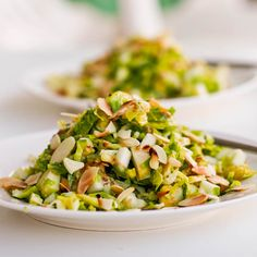 Brussels sprouts #salad with apples and almonds. Topped with a zesty mustard lime dressing. #vegan #glutenfree