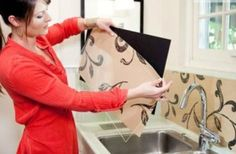 DIY Backsplash -  use sheets of plexiglass to cover your favorite patterned paper .  You could use wallpaper, scrapbook paper, wrapping paper, vintage postcards, maps, photos, or sheet music!