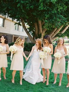 short strapless champagne bridesmaid dresses | all white bouquets | A Totally Laid-Back Black Tie Wedding (Yes, It's Possible!)