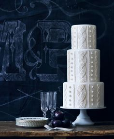Inspired by cable-knit textures, this wedding cake is original and chic.     Cake by  Moo Milk Bar.   Chalkboard Design by  Creative-e.  Vintage china from  Cynthia Martyn Fine Events.   Crystal champagne flutes from  Chair-Man Mills.  Paint from  Benjamin Moore  in Black Chalkboard.