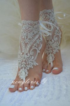 ivory Beach wedding barefoot sandals Ivory Barefoot by newgloves, $25.00. Or for dancing barefoot at the reception