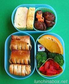 Contents of preschooler lunch: Tamagoyaki rolled egg (my tutorials here for both traditional and shortcut versions), teriyaki pineapple chicken meatballs (Aidells brand, my favorite), orange wedge, cheese cube, steamed broccoli and red bell pepper, and puff pastry appetizers with sweet sauteed onion, sage and Gorgonzola cheese