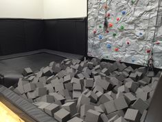 Indoor trampoline with foam pit and rock climbing wall!
