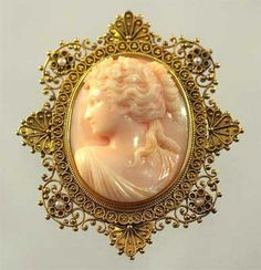 Pale peach coral cameo in 14K gold Etruscan-style frame with four seed pearls, c. 1890