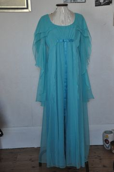 Beautiful 70s Angel sleeve chiffon dress in aqua, really stunning, from Calling All Hipsters Vintage on FB,