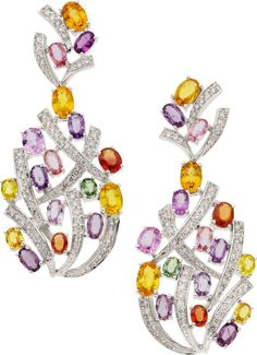 The earrings feature oval-shaped pink, yellow, green, purple, and orange sapphires weighing a total of 10.83 carats, enhanced by full-cut diamonds weighing a total of 1.39 carats, set in 18k white gold, completed by posts and friction backs. Gross weight 18.43 grams.