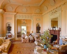 pale apricot walls of this formal English drawing room adorned with decorative plaster and bas reliefs ~ Gervase Jackson Stops design