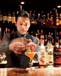 Bartender Shinobu Ishigaki carefully assembles his Claudia cocktail at Tokyo's Bar Ishinohana