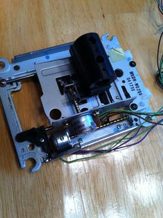 Two cdroms and one floppy drive make up this cnc machine made from old computer parts. Mach3 controlled each of the three bipolar stepper motors. An Arduino mini controlling an LED srtip.