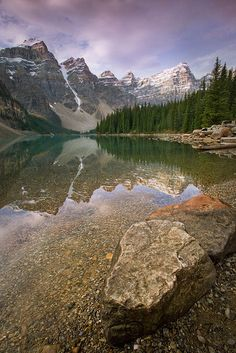 Water so clear you can see the mountains reflection.  [Moraine lake at Banff national park in Canada]