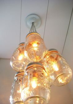 Mason Jar light fixture.  Cute, affordable and very country cottage!