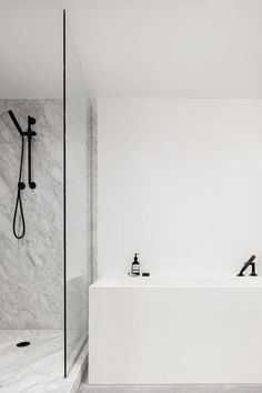 A cross between a hotel room and loft apartment, the space required a simple yet warm design treatment that would suit its diverse occupants. The Saint-Laurent apartment is located in Mon. Minimal Bathroom, Modern Bathroom, Small Bathroom, White Bathrooms, Bathroom Showers, Bath Shower, Open Showers, Marble Showers, Bathroom Wall Decor