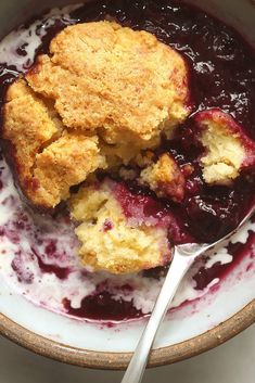 NYT Cooking: This cobbler, which comes from the kitchens of Chez Panisse, prizes the berries above all, using only 1/3 cup of sugar. The dough rounds for the top are placed so they don't cover all the berries, and the juice from the berries bubbles up around the dough.