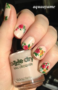 Very unusual design, but very pretty roses.. that stand out due to nude background.