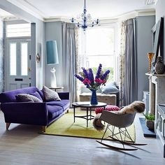 Eclectic living room with purple velvet sofa The understated grey backdrop in the living room is enlivened with lush textures, warm colours and Victorian details. Eclectic Living Room, Home Living Room, Living Room Designs, Living Room Decor, Eclectic Decor, Lila Sofa, Modern Victorian Homes, Victorian Terrace, Victorian House