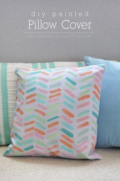 Simple DIY brushstroke Painted Pillow Cover! Delineateyourdwelling.com