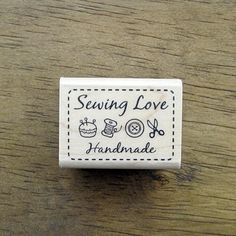 """A cute craft rubber stamp with the words """"Sewing Love"""" and """"Handmade"""" and icons of pushpin, thread spool, button, and scissor. Perfect for a cute creative handmade projects!4cm x 3cm(1.58in x .75in) $8.50"""
