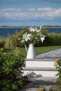 A simple vase of lilies at a modern wedding in Nantucket, MA.  Photo by: http://katiekaizerphotography.com/ Flowers by: http://flowersonchesnut.com/