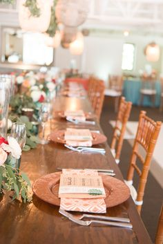 Sage green, white peonies, red roses, long table length florals, copper charges, succulents galore, turquoise filled vases.