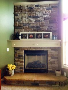 Custom built stone fireplace and concrete hearth with rough rock face. Designed and built by www.readyIIrock.com visit us today for more custom remodeling, outdoor living spaces and concrete counters. #hearth #concretecounter This hearth was built using 5000psi concrete with buff additives and sanded for a sandstone finish with a rough rock edge. Fireplace was built using Heritage Stone Veneer.
