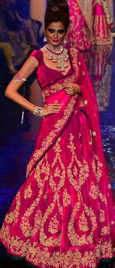 Shyamal & Bhumika lehenga. love the statement necklace, armlet and cuff.