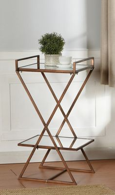 Clean lines, sleek finishes, and a unique design make this Glass Accent Table with Gold Metal Frame the epitome of your modern decor. Glass Shelves, Display Shelves, Small Accent Tables, Pedestal Stand, Mirror With Shelf, Mirror Shelves, End Tables, Gold End Table, Antique Gold