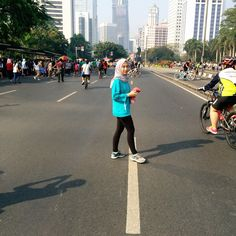 After finishing 10K Run (Most of Walkin) on Car Free Day, Jakarta Indonesia. Photos taken on August 2015