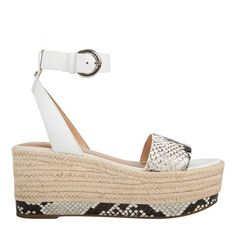 Braided jute and faux snake wrap the platform of our Gigli sandal touting a single band at the vamp and an adjustable buckle at the ankle Strappy Flats, Studded Flats, Wedge Sandals, Heels, Metallic Leather, White Leather, Natural Leather, Espadrilles, Footwear