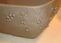 carved pottery designs