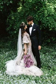 Anastasia Starzynski married Joshua Elias in a magical garden wedding set in Duneira, Mount Macedon in Victoria.  Dress: J'aton Couture Shoes: Miu Miu  Hair: Marie Uva Make-up: Belinda Zollo Groom's attire: Tom Ford Photographer: Erin & Tara Venues: Duneira (day); A Day on Earth (evening) Catering: Cookes catering (day); Da Noi (evening) Florist: Cecilia Fox Music: Animata string quartet; Marinucci jazz ensemble Stationery: Writt...